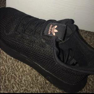 Tubular black adidas shoes